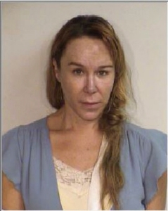 This June 2016 booking photo released by the Maui County Police Department shows Alexandria Duval. A woman who was driving a vehicle when it plunged off a Hana, Hawaii cliff is charged with second-degree murder in the death of her twin, who was in the passenger's seat. Prosecutors say Alexandria Duval, who is also known as Alison Dadow, intentionally caused the death of her identical twin sister, Anastasia Duval, also known as Ann Dadow. The incident took place on May 29, 2016. (Maui County Police Department via AP)